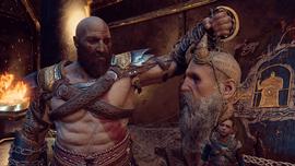 Kratos sosteniendo la cabeza de Mimir