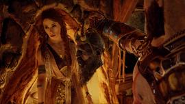 Kratos entregándole la cabeza de Mimir a Freya
