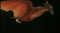 Fire Rodan carrying the container