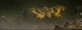 Mothra attacks Godzilla with scales