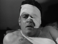 Godzilla-King-of-the-Monsters-Raymond-Burr-wounded