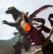 Godzilla golpeando a kamacuras