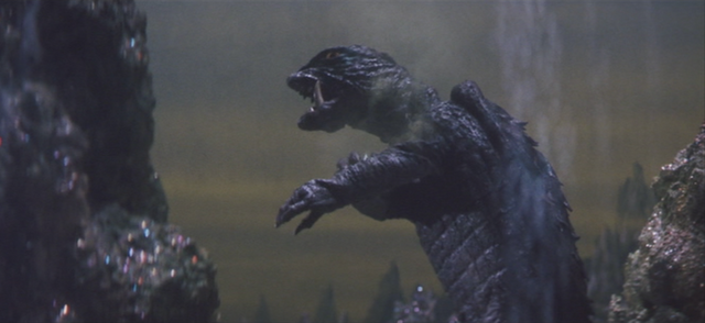 File:Gamera - 5 - vs Guiron - 39 - Gamera removes the shurikens.png