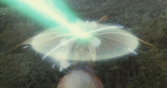 File:Grand King Ghidorah's force barrier repelling Mothra's Mineral Chest Beam.jpg