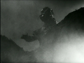 Gojira - Godzilla spies Serizawa in Tokyo Bay