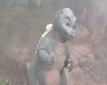 Little Godzilla watching SpaceGodzilla
