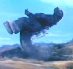 Godzilla rutsch auf seinem Schwanz