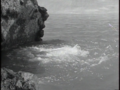 Godzilla Raids Again - 12 - The monsters fighting underwater, causing a spout of bubbling foam