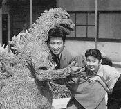 The Original Godzilla Hugs two Japanese People