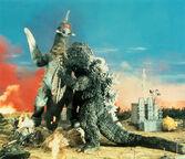 Godzilla and Gigan fight.
