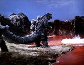 Son Of Godzilla - Godzilla Stands In Front Of A Red Lake
