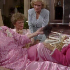 Dorothy holding Stan's toupee.
