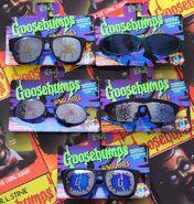 5 different Goosebumps sunglasses spiderweb logo in pkg