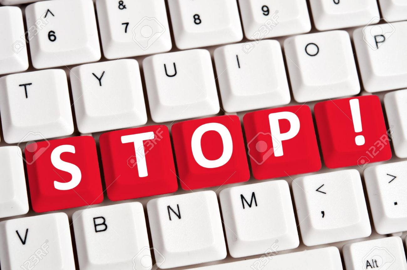9627512-Stop-word-on-white-keyboard-Stock-Photo