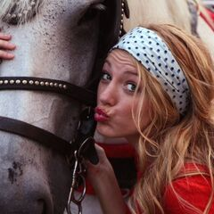 Serena posing with a horse
