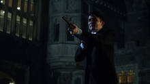 Penguin pointing his gun at Jim Gordon and Theo Galavan