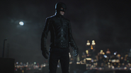 Bruce Wayne overlooking Gotham City in his new costume