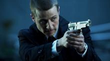 Gordon aiming his gun at Lamond
