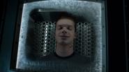 Jerome Valeska's corpse inside a pod
