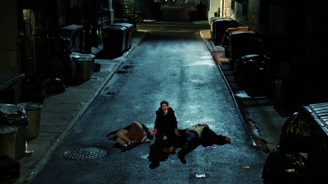 File:Bruce kneeling at his parents dead bodies screaming.png