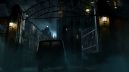 A bus driving into Arkham Asylum
