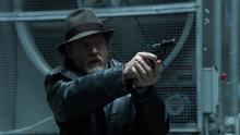 Bullock aiming his gun at Potolsky