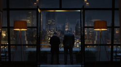 Jim Gordon and Carmine Falcone talking on Jim's balcony