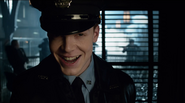 Jerome laughing at Commissioner Essen while the rest of the Maniax shot up the GCPD headquarters