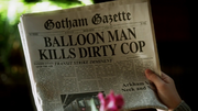 Bruce showing Alfred the latest Gotham Gazette issue