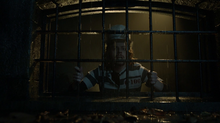 Jervis Tetch watches as Nathaniel Barnes breaks out of Arkham Asylum