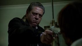 Gabe aiming his gun at Derek Delaware
