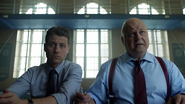 Jim Gordon and Nathaniel Barnes recruiting members for the Strike Force