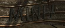 Napis MINH na deskach na rusztowaniu na jednej z budowli w mieście Mora Sul (by Kubar906)