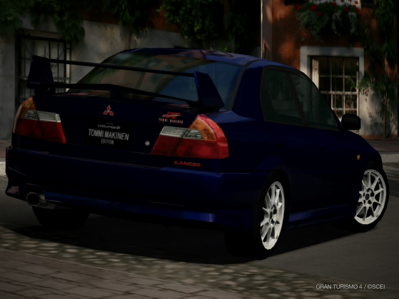 File:Mitsubishi Lancer Evolution VI GSR TOMMI MAKINEN EDITION '00 (Back).jpg