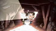 Stan y Ford explorando una cueva