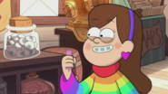 S2e9 mabel holding candy
