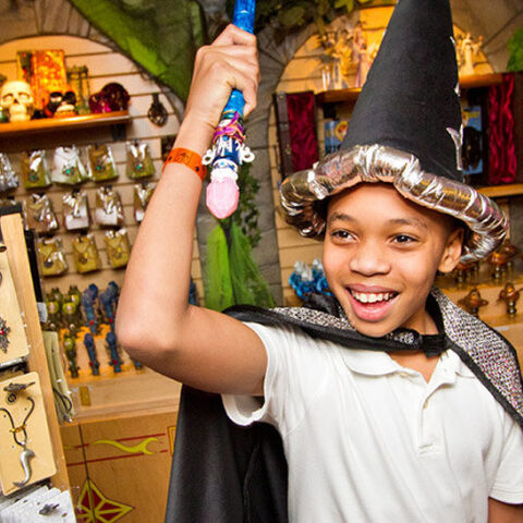 A kid picks out the wand he wants to use while playing MagiQuest
