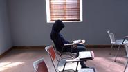 Dina Handcuffed to a school desk