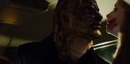 206 - Arbok threatening Angelina in his Wesen form.