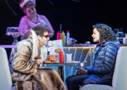 Andy Karl and Carlyss Peer as Phil and Rita, respectively, in a diner
