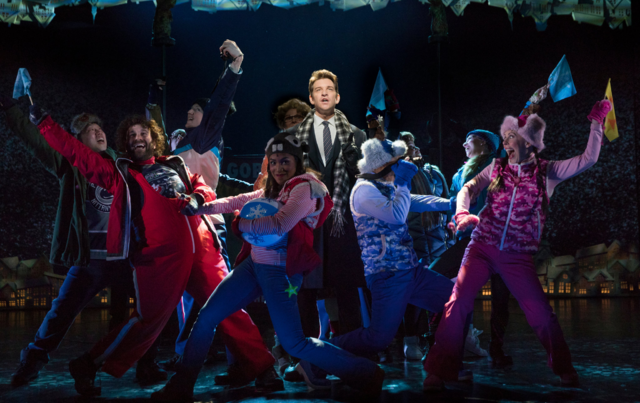 File:Phil surrounded by townsfolk in the Broadway production.png