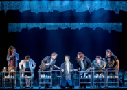 Andy Karl as Phil Connors alongside characters holding trolleys