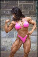 Denise Masino flexing in pink bikini