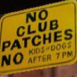 <i>NO KIDS-DOGS AFTER 7 PM</i>, sign at the Greasy Chopper.