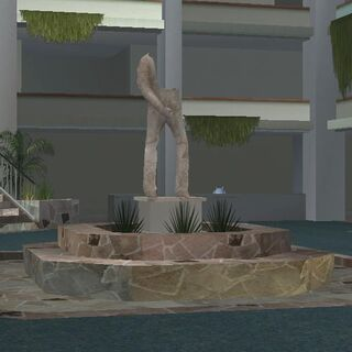 The middle statue.