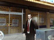 Niko egy bezárt Cluckin' Bell előtt