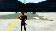 Róbert egy fegyverrel pózol a reptéren