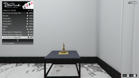 PenthouseDecorations-GTAO-TabletopPieces19-GoldStatueofHappiness