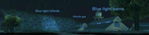 Blue light barns hillside gap