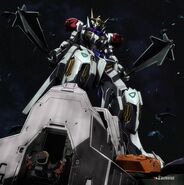 Gundam Barbatos Lupus with Twin Maces standing over Sandoval Reuters